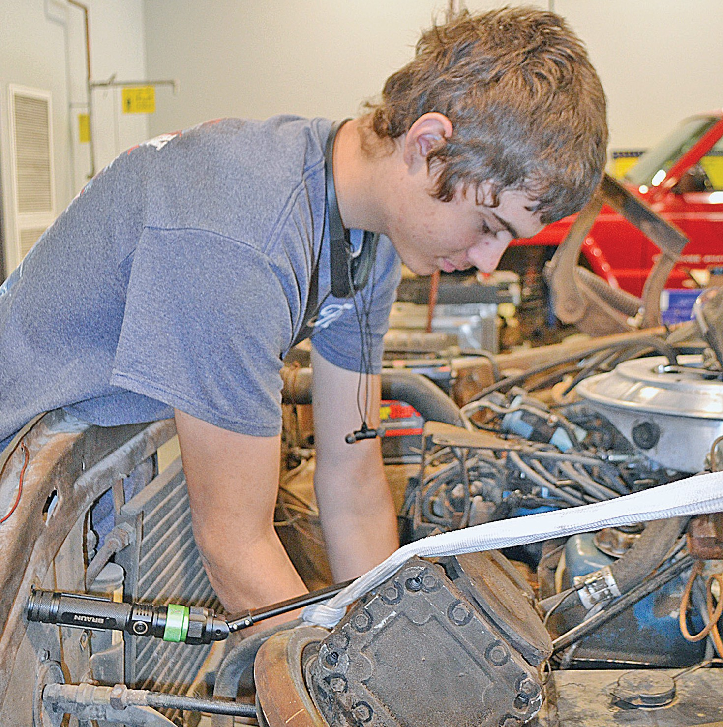 I2 student Michael Burke working on car